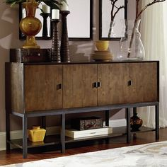 Featuring a clean-lined design and warm hazelnut and ebony finish, this eye-catching sideboard effortlessly blends rustic style with modern appeal. Set it in the dining room to keep serveware effortlessly corralled, or let it be a stage for framed photos and objets d'art in the den.