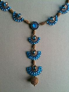 Capri Blue and bronze gold fan necklace by Jeka Lambert front detail.  Seed bead woven, bead embroidery, beaded beads