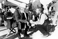 filmmaker John Huston and lead actor Paul Newman on the set of The Life and Times of Judge Roy Bean (1972).
