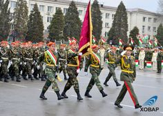 Officers and enlisted servicemen of the Tajik Ministry of Emergency Situations and Civil Defense marching past the Ismail Samani monument in Dushanbe at the 2013 Tajik National Army Day Parade.