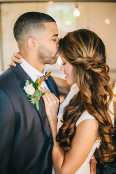 side-swept hair with a twist, photo by Angel He Photography http://ruffledblog.com/tampa-modern-wedding-ideas #weddinghair #bridal #beauty