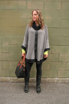 City chic in her #CharliePaige cape coat and faux leather #Louenhide bag