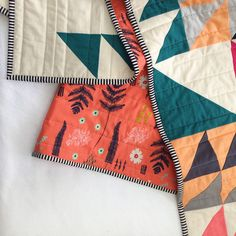 This lightweight and comfy throw quilt measures 44 by 60inches. Backed by Cotton+Steel's colorful botanical print and bound in a fun black and white stripe. The white in the quilt is a soft bone color rather than a stark white, as can be best seen in the close up photo. All of my quilts are …