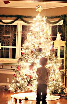 "Camera settings to recreate the ""glowing Christmas tree""  - love the Christmas styling and lighting of the tree; along w/ the young boy gazing at it. #bywstudent"