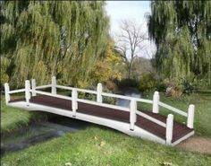 5x14 Autumn Trail Single Rail Bridge by Fifthroom. $3999.00. Please Note: Item delivered by motor freight (common carrier).Customer may need assistance to unload. Capacity: 2200 lbs. Maintenance-free Trex® Accents composite decking. Features rounded & sanded edges. Free Shipping - ships in easy to assemble kit form. Though this bridge may not look especially heavy-duty with its elegant railings, the treated pine beams and composite decking give it a high level of durability...