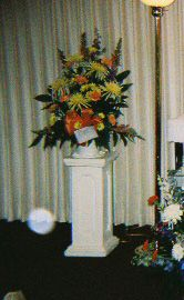 Michelle D. took this photo at a funeral home for her father's wake. The orb is to the bottom left of the flowers.