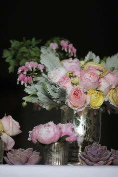 Flowers by Sachi Rose. (Floral arrangement in vintage mercury glass with pink peonies, peach garden roses, grey dusty miller, bleeding hearts, succulents, and yellow ranunculus.)