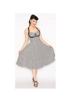 Rockabilly Girl är en 50-tals svart-prickig vit klänning med en twist!