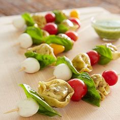 """Colorful addition to any meal. These tasty Tortellini """"Caprese"""" skewers feature a summer-fresh flavor combination of mozzarella and basil, pear or cherry tomatoes and whole wheat three cheese tortellini."""