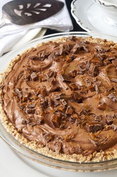 Aunt Marg's French Silk Chocolate #Pie recipe - Silky smooth chocolate pie with a crumbly Pecan Crust topped with #chocolate covered toffee candy bars!