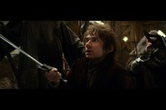 Bilbo recoils from the bear that may or may not be Beorn. - The Hobbit: The Desolation of Smaug