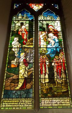 One of the beautiful stained glass windows in the 900 year old St Mary's Church in Rye, East Sussex, England. By B Lowe