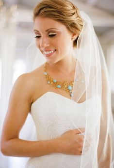 Brides.com: Wedding Hairstyles that Work Well with Veils. A Soft Updo Wedding Hairstyle for Long Hair. Keep your tresses soft and natural with a loose updo. Pin a simple, fountain veil toward the back for a classic look.  Browse more wedding updos.