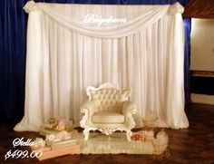 8x8 Fabric Draping, French White Chair and Area Rug with gifts