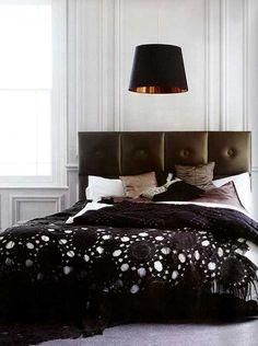 love the black crochet throw over the white comforter
