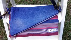 A personal favorite from my Etsy shop https://www.etsy.com/listing/475368776/zippered-flap-purse-with-detachable