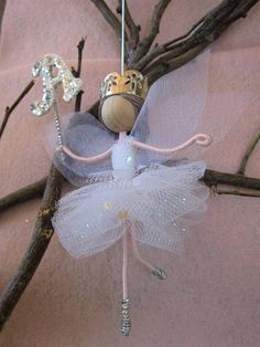White Ballerina Fairy or White Ballerina Angel is a fairy doll dancing in the birthday parties, scattering love and happiness to every body. - This ballerina angel is wearing a white glittering tutu dress, a pair of silver dancing shoes. - Her transparent wings made out from high