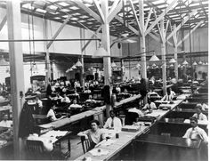 Census Bureau employees from the Population Division working in a temporary building during the 1910s.