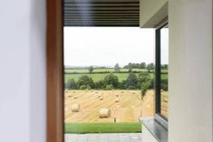 Window view of underside of zinc canopy, outdoor terrace and bales of hay in the distant field. Passive House Design, Irish Landscape, Architectural Services, Canopy Outdoor, Window View, Dublin, Terrace, Windows, Ramen