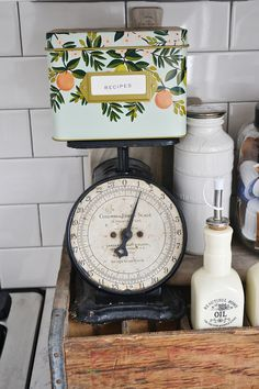 Lots of neutral home decor inspiration & where to find some lovely home decor! Love this floral recipe box & antique kitchen scale!