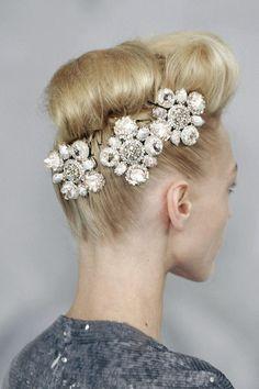 Sasha Pivovarova wearing a headpiece from Chanel Couture S/S 2008