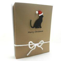 Handmade Christmas Cards - Black Cat Silhouette with Santa Hat - 10 pack. $12.50, via Etsy.
