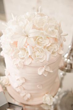 Beautiful cake with flowers http://www.prettymyparty.com/pink-and-silver-dessert-table/