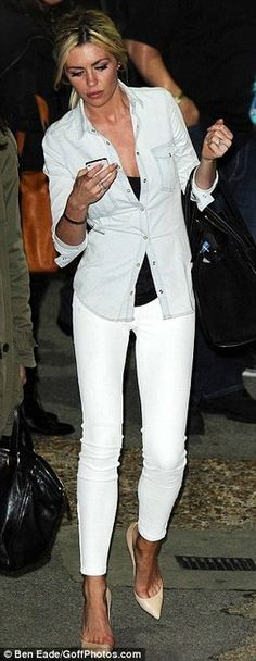 Abbey Clancy in white skinny jeans, Zara top, and Christian Louboutin heels.