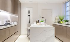 Love the nude high lacquer cabs against the marble waterfall...Knightsbridge II Taylor Howes