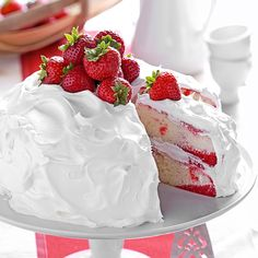 Strawberry Poke Cake Recipe -That classic spring treat—strawberry shortcake—takes on a wonderful new twist with this recipe. Strawberry gelatin and strawberries liven up each pretty slice of this lovely layered cake that's made from a convenient boxed mix. —Mary Jo Griggs, West Bend, Wisconsin