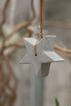 Hanging Concrete Star by Tutti & Co.Mini Hanging Concrete Star by Tutti & Co. Cement Art, Concrete Cement, Concrete Crafts, Concrete Projects, Concrete Design, Star Decorations, Christmas Decorations, Holiday Decor, Christmas Crafts