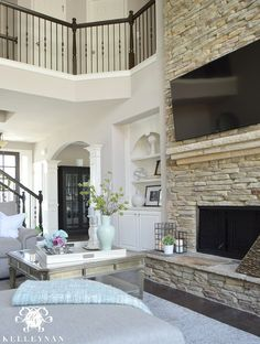 Kelley Nan: Cool Tone Spring Ready Living Room Tour- Two story neutral living room with two story windows in family room Coastal Living Rooms, Living Room Decor, Bedroom Decor, Stacked Stone Fireplaces, Living Room With Fireplace, Two Story Fireplace, Two Sided Fireplace, Foyer Decorating, Fireplace Remodel