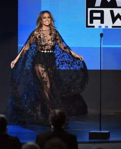 Jennifer Lopez Photos - Host Jennifer Lopez speaks onstage during the 2015 American Music Awards at Microsoft Theater on November 22, 2015 in Los Angeles, California. - 2015 American Music Awards - Show