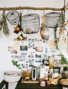 love all these kitchen images, although I can't stop looking at this particular branch/pot rack and wonder how some of those items get/stay up there!  via a daily something