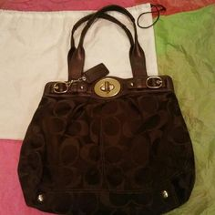 Coach Hobo Nice larger size bag Its dark brown with the letter C a little lighter color. It has 2 shoulder straps. It is authentic  Has a nice light purple color on the inside.  Also has a separate pocket on the inside, for storing things. Its in perfect condition,  only a little tarnished on the  Buckle that opens the bag. I never used it, bought it off of a site,  and thats all that was wrong with it.  Which can easily be fixed. Does include dust bag. Make offers if you want ***** Coach…