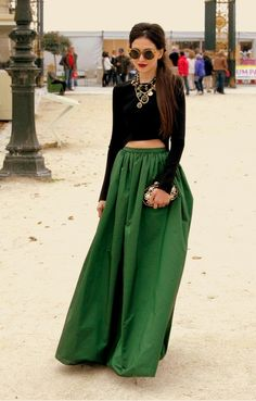 Must Have Skirts. green skirt with full-sleeve black crop top and statement necklace <3