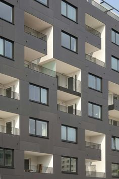 Anthractite EQUITONE facade panels, white loggia's. Appartment ...