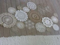 Lace doilies as a pattern over a large board for escort cards, or as part of a backdrop on the interior barn wall