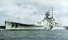 32700 ton Scharnhorst as constructed: found to be very wet ships during trials, she and her sister Gneisenau later received raked 'Atlantic' bows and funnel caps.  The Germans saw them as battleships, the allies as battlecruisers on account of their high (32 knot) speed and relatively light (9 x 11 in) armament.