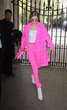 On her way to the Fendi Spring 2018 show, where Gigi modeled a few standout looks, the supermodel appropriately wore a pink suit from the label. The checked