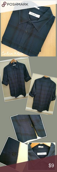 🚵 Calvin Klein Men's Casual Button Down? Navy * Calvin Klein men's casual, button-down shirt. Navy blue & black plaid. Sleeves can be worn long or rolled-up. Front pockets. * Size large * 100% cotton * Good used condition. 1 button on sleeve had to be replaced (see pic).  TOP SELLER • BUNDLE & SAVE • FAST SHIPPER 🚀 Calvin Klein Shirts Casual Button Down Shirts