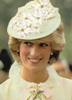 """The Princess of Wales wore this hat designed by Linda Mattock for """"Lillie"""" When she was in Canada in 1983 dressed in period costume of the Klondike era. The hat, was designed specifically for Diana, and it is a cream petal straw trimmed with period velours au sabre silk ribbon, silk flowers and pearl sprigs."""