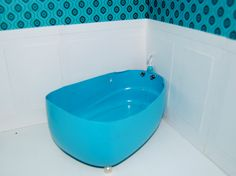bathtub...made from bottom of a laundry detergent bottle, metal jewelry beads for knobs, screw hook for faucet, and 4 pearl beads for bottom legs.  WHAT ABOUT BUYING A BREAD BAKING PAN AT THE DOLLAR STORE AND ATTACHING LEGS WITH EPOXY RESIN TO THE BOTTOM?