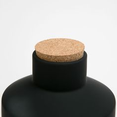 Decorative ceramic jar with cork lid