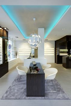 Optik Weiss by Heikaus, Aichtal Germany eyewear store design Ceiling Draping, Black Ceiling, Medical Design, Open Fireplace, Optician, Glass Table, Retail Design, White Wood, Store Design