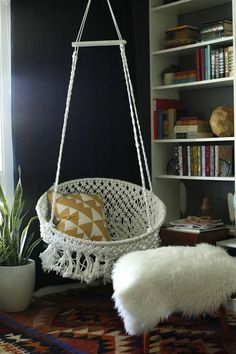 Trade in your furniture for a cozy hammock chair.   - HarpersBAZAAR.com