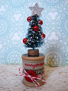 small bottle brush tree on a spool Lori Hairston Christmas Mix, Mini Christmas Tree, Vintage Christmas Ornaments, Primitive Christmas, Christmas Projects, All Things Christmas, Holiday Crafts, Christmas Holidays, Christmas Bulbs