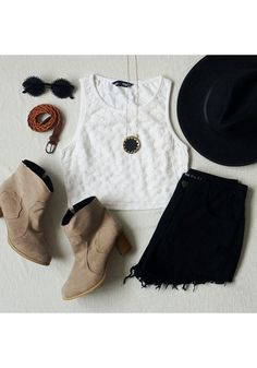 White crop top, black high-waisted shorts, ankle boots, & sunglasses. My Older daughter!