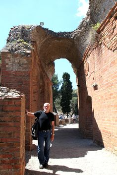 Steve Chambers under one of the many Roman arches leading to the subterranean caverns where gladiators waited before engaging in combat in Teatro Greco. - See more at: http://chambersarchitects.com/blog/248-taormina-sicily-refuge-for-ancients-artists-and-writers.html#sthash.V6tcTDnP.dpuf And read all of our blogs at: http://chambersarchitects.com/blog.html
