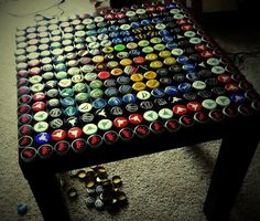 Bottle cap tables with poured resin surface